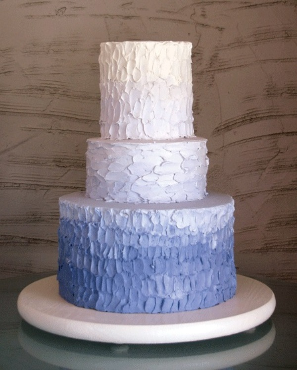 a textural white and lilac wedding cake with an ombre effect is a chic and stylish idea