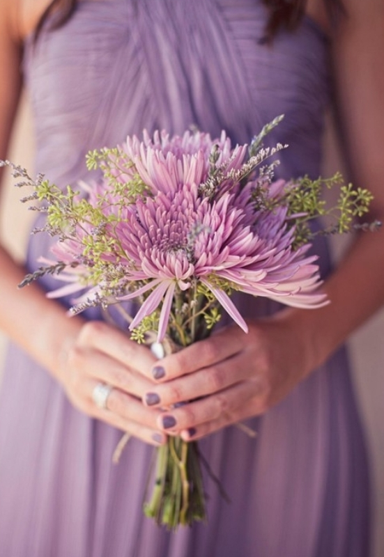 a lilac draped bridesmaid dress and a matching lilac colored bouquet with greenery