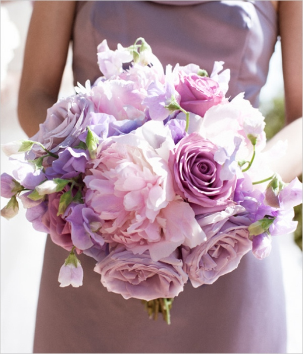 a pink and lavender colored wedding or bridesmaid bouquet looks like a large candy
