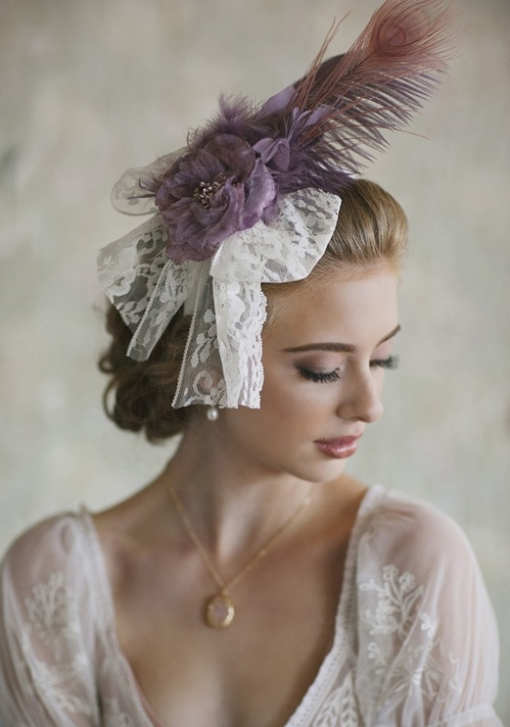a unique vintage wedding headpiece of white lace and lilac feathers for a beautiful accent