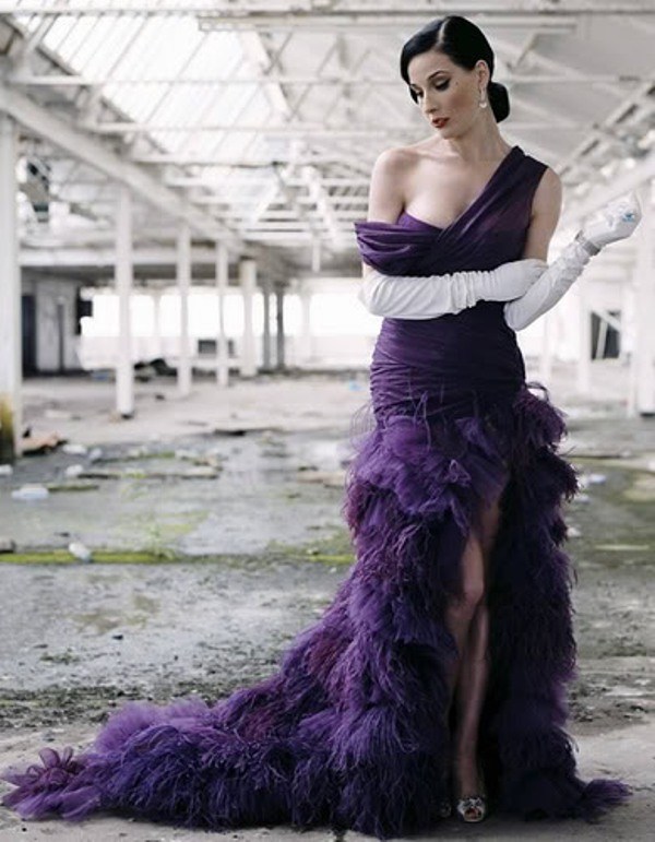 a deep purple one shoulder with a draped bodice and a feather skirt with a train plus white gloves