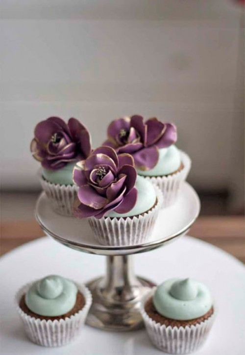 chic and delicious wedding cupcakes done with mint icing and large purple sugar blooms with gold edges are amazing for a spring or summer wedding