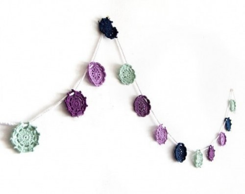 a purple, lavender and mint doily wedding garland is a nice decoration for a spring or summer wedding