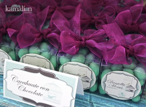 mint candies and purple bows on top in sheer boxes are nice wedding favors that you can DIY