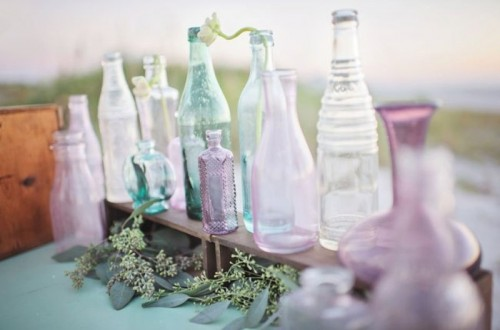 mint, lavender and purple mismatching bottles as wedding decor, they can be also used for creating centerpieces