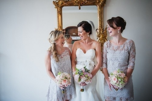 mismatching white lace bridesmaid dresses like these ones will be amazing for a spring or summer boho wedding