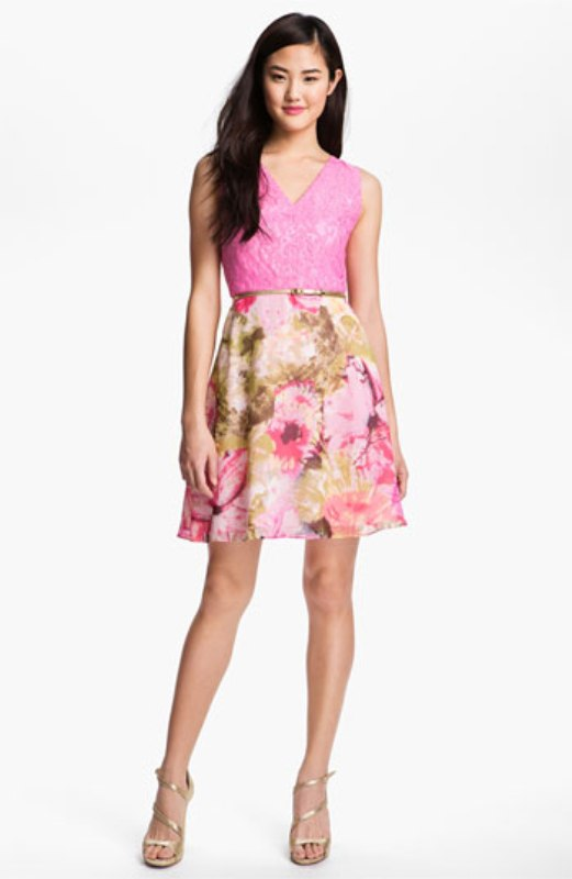 a bright bridesmaid dress with a hot pink lace bodice and a matching floral A line skirt is a fun and bold idea for a summer wedding