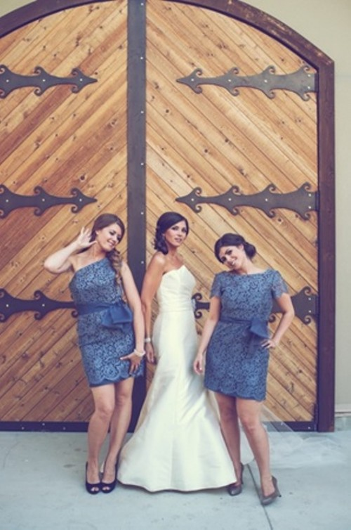 mismatching blue lace over the knee bridesmaid dresses with sashes are lovely for spring or summer weddings
