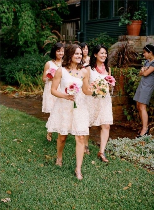 matching blush lace one shoulder A-line bridesmaid dresses, shoes and statement accessories for cute spring or summer bridesmaid looks