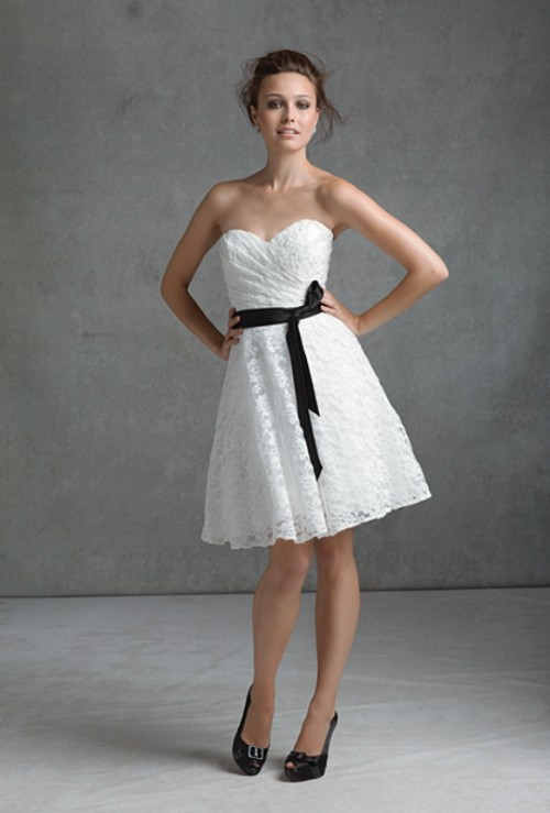 a strapless white lace A-line bridesmaid dress with a draped bodice and a black sash feels retro and looks cute and cool