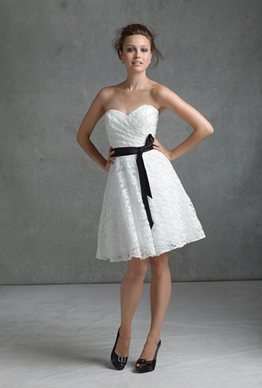 a strapless white lace A line bridesmaid dress with a draped bodice and a black sash feels retro and looks cute and cool