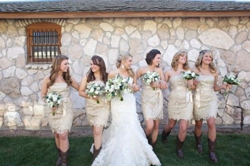 neutral lace strapless over the knee bridesmaid dresses paired with cowboy boots are a lovely and cool idea that will look fun at a rustic wedding