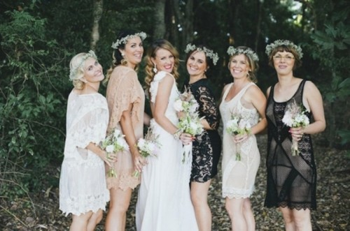 mismatching black, nude and white lace knee dresses are lovely for a boho wedding in any season