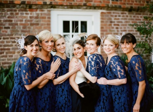 navy lace A-line bridesmaid dresses with scoop necklines and short sleeves are classic for many weddings