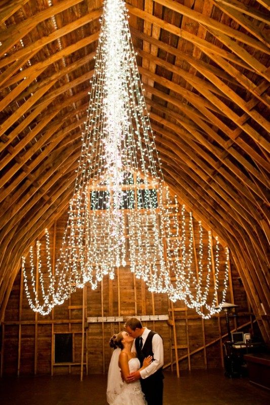 a creative wedding lights canopy going over the space is a lovely and beautiful idea to light up your space