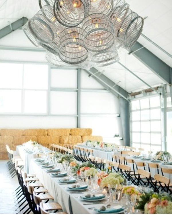 a white chandelier of cages is a whisical idea with a vintage feel and it looks very unusual and bold