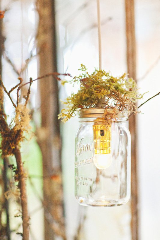 jars with bulbs and moss on top are nice for a woodland or fairy tale wedding