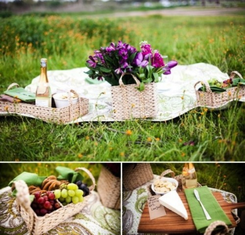a romantic wedding picnic with layered blankets, baskets with blooms and food and drinks