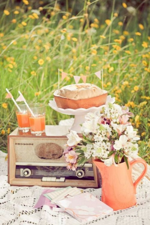 a retro wedding picnic with a lace blanket, pastel blooms, a vintage radio, a pie and juice for a summer wedding