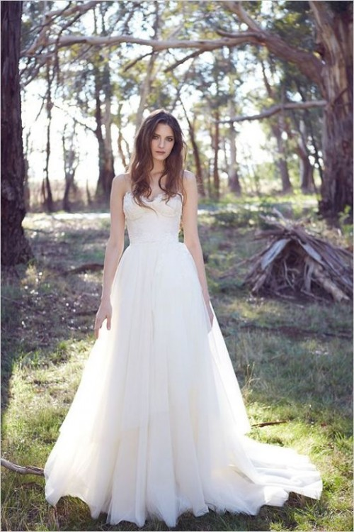 a chic modern wedding dress - a strapless gown with a bustier and a train is very romantic