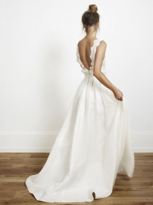a beautiful wedding dress with a lace bodice and an A-line maxi skirt plus an open back