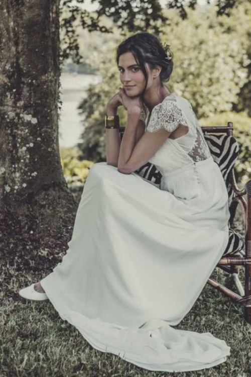 a romantic yet casual wedding dress with a lace back, cap sleeves and a plain skirt