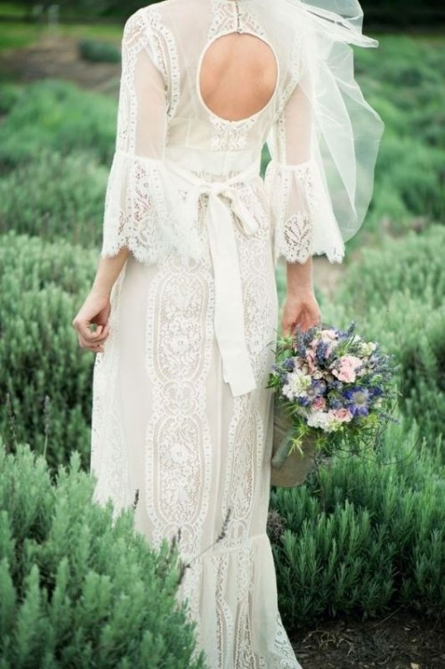 a whimsy fitting lace wedding dress with a keyhole back, short bell sleeves and a bow