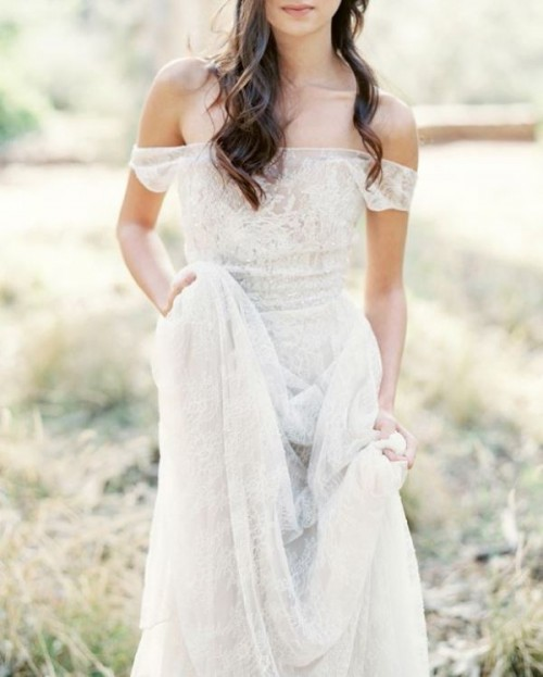a lace off the shoulder wedding dress brings a boho feel and a touch of chic
