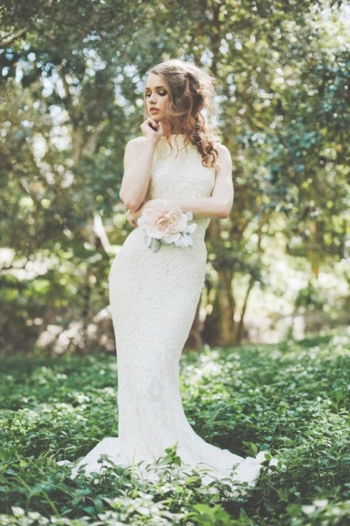 a neutral lace fitting wedding dress with no sleeves always works and looks pretty