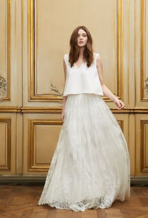 a non-typical wedding separate with a plain top with floral shoulders and an airy lace A-line skirt