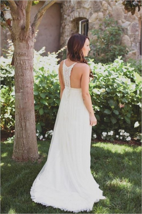 a boho plain wedding dress with a macrame racer back and no sleeves looks chic and feels relaxed