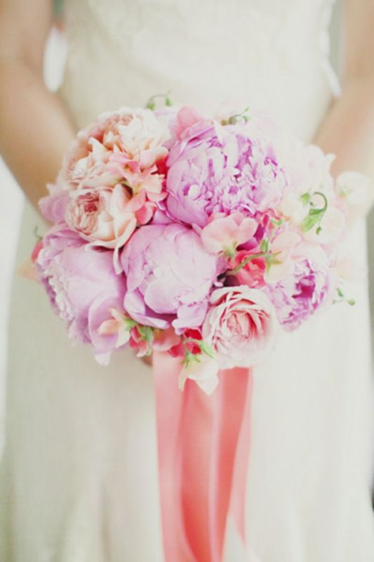 hot pink and peachy peony wedding bouquet with long ribbons is a bold idea for a spring or summer bride