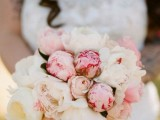 a pretty marshmallow-styled wedding bouquet composed of white and pink peonies is a very simple to realize and beautiful idea of a wedding bouquet