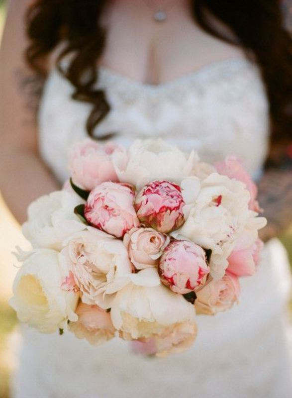 a pretty marshmallow styled wedding bouquet composed of white and pink peonies is a very simple to realize and beautiful idea of a wedding bouquet