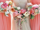 colorful wedding bouquets with orange ranunculus, pink peonies, white and pastel anemons and greenery for a colorful summer wedding