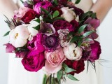 a jewel-tone wedding bouquet with purple, hot pink, white and pink peonies and some touches of greenery for a bold fall wedding