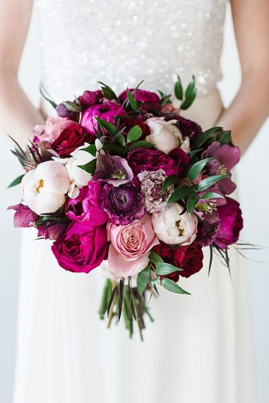 a jewel tone wedding bouquet with purple, hot pink, white and pink peonies and some touches of greenery for a bold fall wedding
