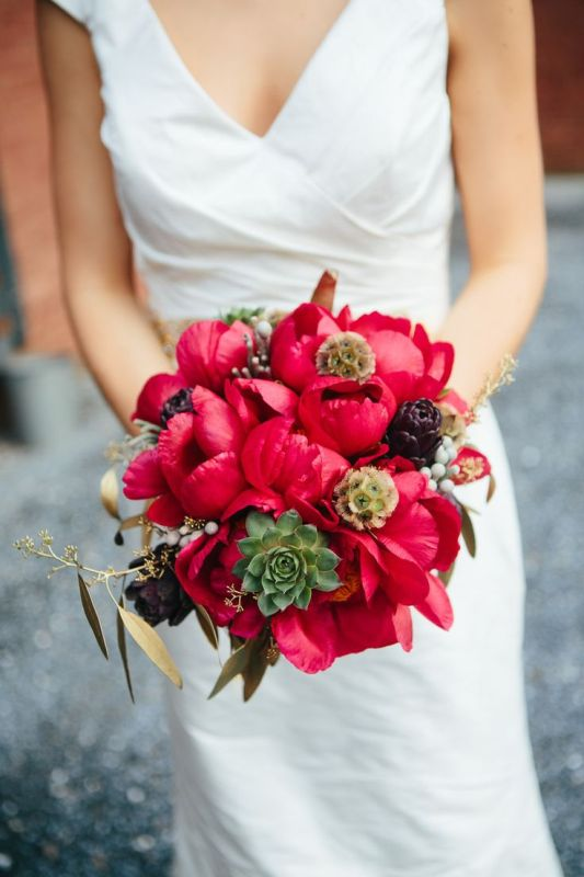 a bold coral peony wedding bouquet with artichokes, succulents and seed pods is a bold idea for a summer or fall wedding