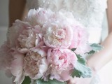 a pale pink peony wedding bouquet with pale foliage is a lovely and chic pastel spring wedding idea