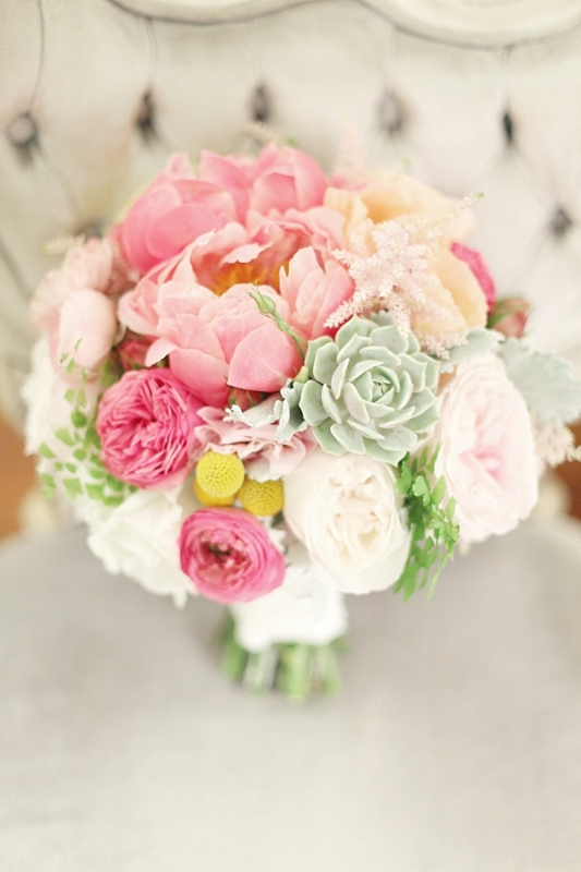 a bright wedding bouquet with pink and blush peonies, hot pink ranunculus, succulents and billy balls is a lovely idea for a summer bride