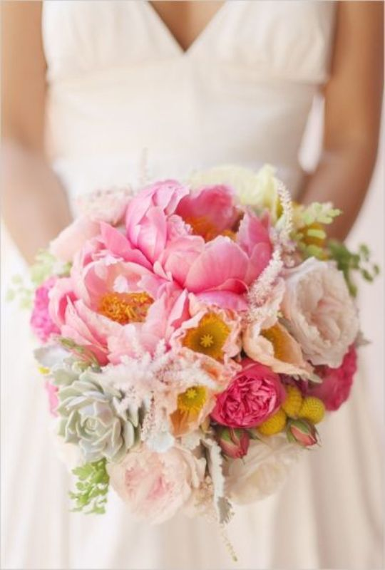 a colorful wedding bouquet with blush and pink peonies, succulents, billy balls and greeery is amazing for spring or summer