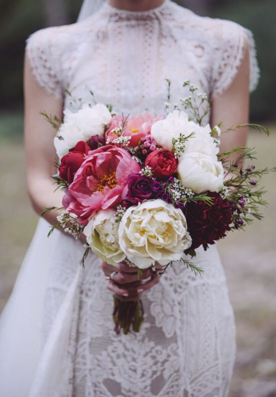 a bold and cool wedding bouquet with white, coral and deep purple peonies, greenery is ideal for a summer or fall wedding