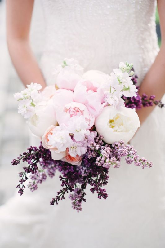 blush and white peonies and lilac compose a beautiful spring wedding bouquet is a chic and beautiful idea