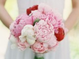 a bright wedding bouquet of white and pink peonies and red ones for a brighter touch is a lovely idea for spring or summer