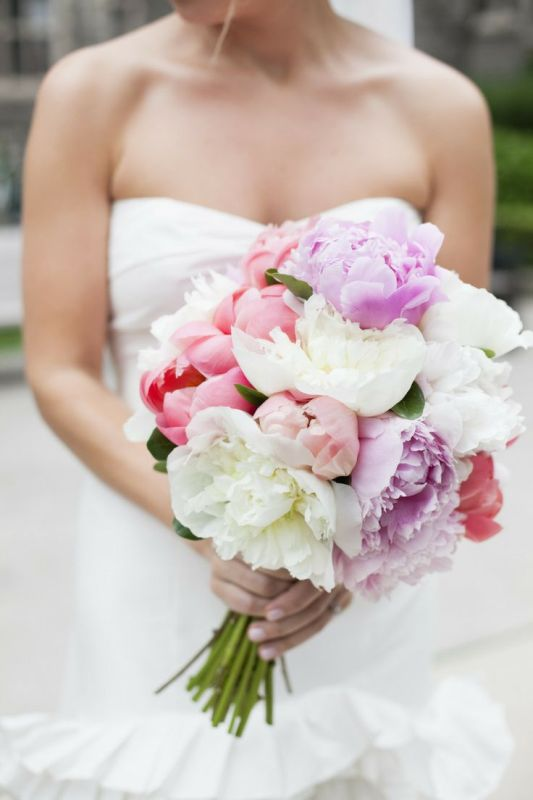 a lush coral, lilac and white peony wedding bouquet for a spring or summer wedding