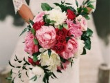 a bold pink, red and white peony wedding bouquet with greenery for a bright spring or summer wedding