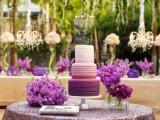 an ombre white to blush and radiant orchid wedding cake surrounded by radiant orchid florals for a bold wedding