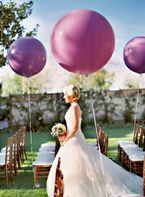 radiant orchid balloons decorating the aisle chairs are amazing to make the space look modern and fun