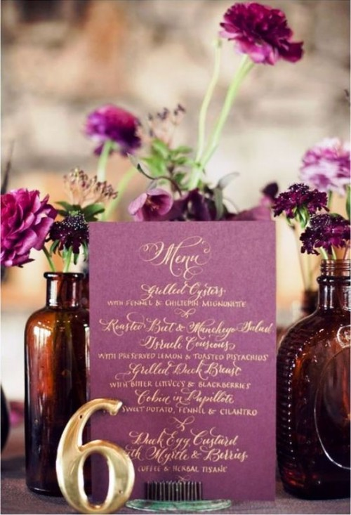 a radiant orchid wedding menu with gold lettering, radiant orchid blooms in apothecary bottles for a refined wedding centerpiece
