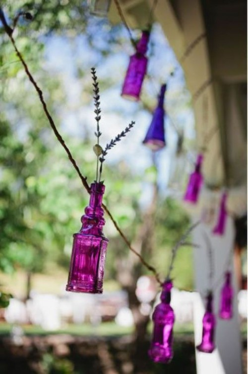 a gorgeous garland of radiant orchid bottles with lavender will be a fun and whimsical decor idea for a bright wedding